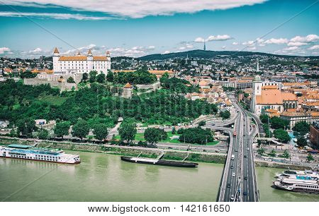 Bratislava is the capital city of Slovak republic. Embankment of Danube river Beautiful castle Saint Martin's cathedral. Cold photo filter. Architectural theme. Travel destination.