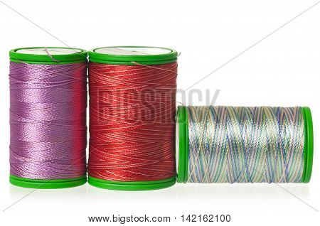 Colorful silk threads isolated on white background