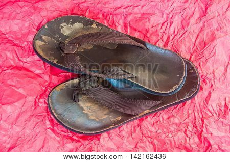 old man shoes on red wrinkled paper