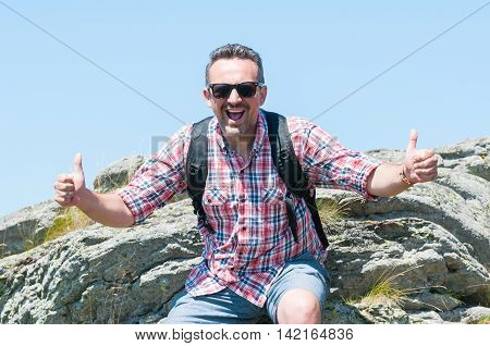 Male Backpacker Being Happy Showing Thumbs Up