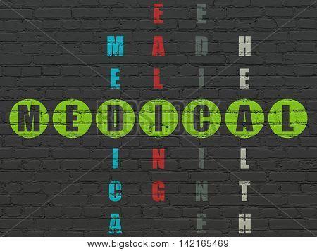 Healthcare concept: Painted green word Medical in solving Crossword Puzzle