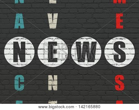 News concept: Painted white word News in solving Crossword Puzzle