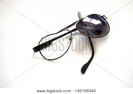 old broken sunglasses isolated on white background