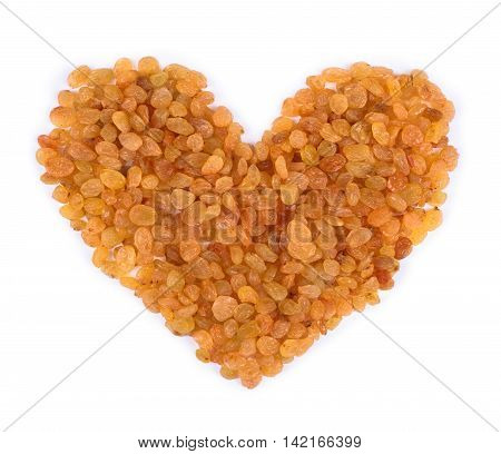 raisins isolated on white background forming a heart shape