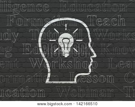 Learning concept: Painted white Head With Lightbulb icon on Black Brick wall background with  Tag Cloud