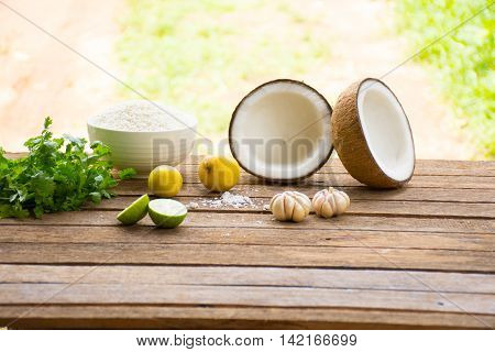 Raw material for food and dessert.Lemon and coconut  and Sticky rice  and coriander on old wooden background outdoor.Raw material Asia food.Raw material Indian food1