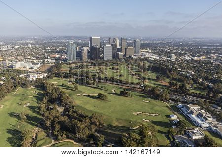 Los Angeles, California, USA - August 6, 2016:  Afternoon aerial view of Century City towers and the Los Angeles Country Club Golf Course.