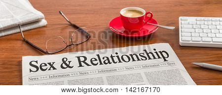 A Newspaper On A Wooden Desk - Sex And Relationship