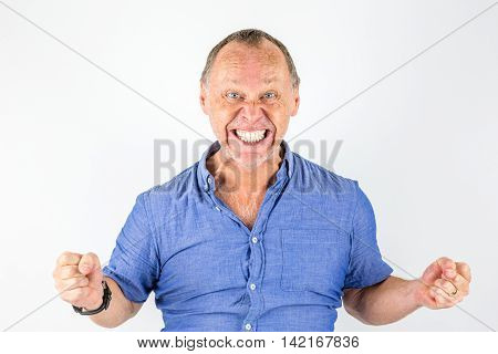 Angry and furious man in blue shirt portrait.
