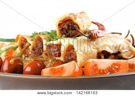 traditional italian cannelloni with tomato and peppers