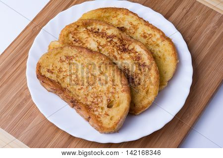 Fried bread slices on wooden background. Traditional Bulgarian breakfast.