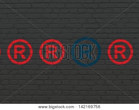 Law concept: row of Painted red registered icons around blue registered icon on Black Brick wall background