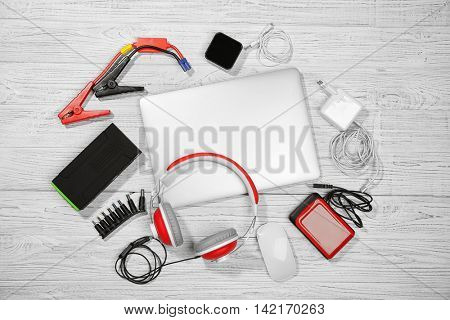 Laptop with accessories. Energy and information safety concept
