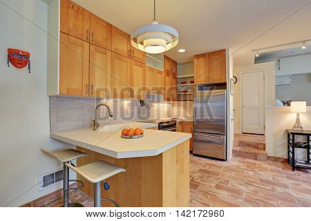 Light Brown Kitchen Interior With Steel Appliances
