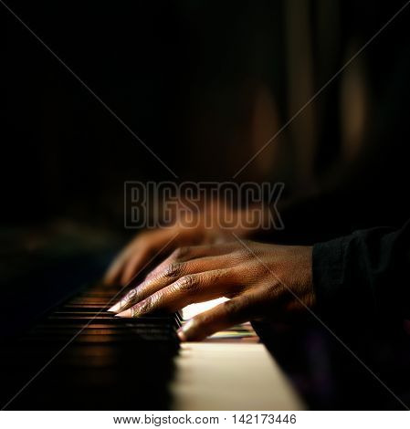 Hands of pianist playing synthesizer close-up