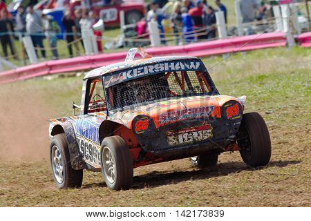 BREDON HILL, UK - MAY 4: An unnamed driver competing in the UKAC autograss series accelerates out of the bottom corner on the oval circuit leading the field on May 4, 2013 in Bredon Hill.