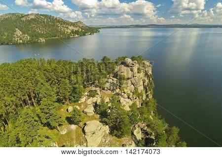 Rocky cliff on a mountain lake Borovoe (Burabay) in Kazakhstan