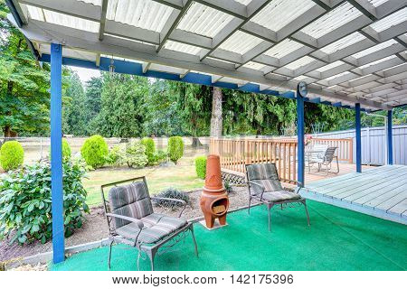 Covered Back Deck With Outdoor Seats And Fire Pit