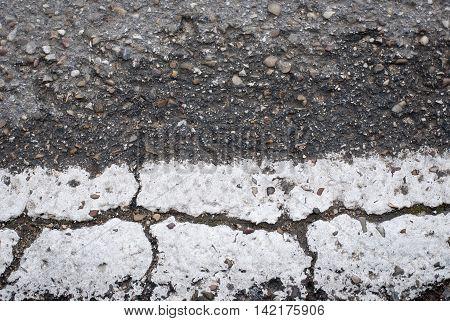 asphalt road background with white line cracked