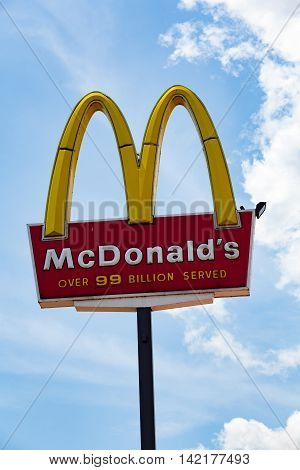 Bloomsburg PA - June 15 2013: An elevated sign for the American fast food restaurant chain McDonalds.