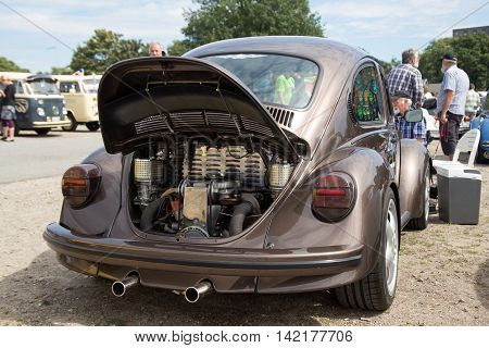 Celle, Germany - August 7, 2016: Engine inside the rear trunk of a Volkswagen Beetle at the annual Kaefer Meeting