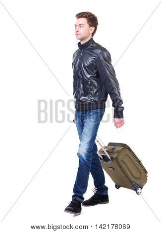 front  view of walking  man  with suitcase.  brunette guy in motion. backside view of person.  Rear view people collection. Isolated over white background. Curly boy rolls a suitcase and looking at
