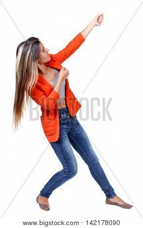 back view of standing girl pulling a rope from the top or cling to something. girl  watching. Rear view people collection.  backside view of person.  Isolated over white background. girl in a red