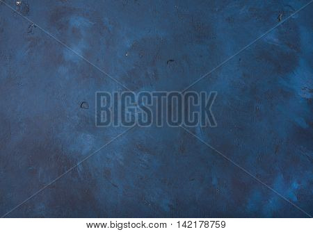 Dark blue painted old plywood texture, background and wallpaper