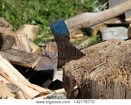 Ax Of The Woodcutter On The Block Of Wood In The Woodshed