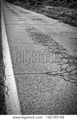 Asphalt road with white road markings lines background
