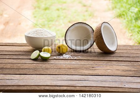 Raw material for food and dessert.Lemon and coconut  and Sticky rice on old wooden background outdoor.Raw material Asia food.Raw material Indian food6