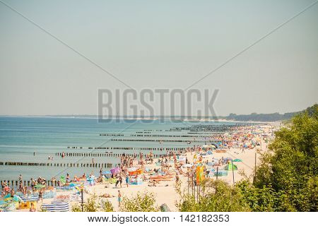 Mielno Poland - June 24 2016: Crowds of sunbathers on the beach in Mielno.