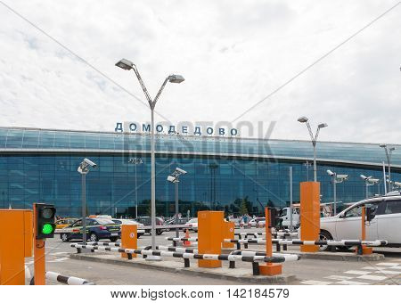 The Moscow region - 31 July 2016: Large modern passenger terminal of Domodedovo and many cars waiting for passengers 31 July 2016 Moscow region Russia