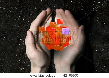 Cube in male hand . Mixed media