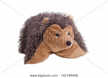 Travel pillow hedgehog shaped which rolled up and buttoned on a light background