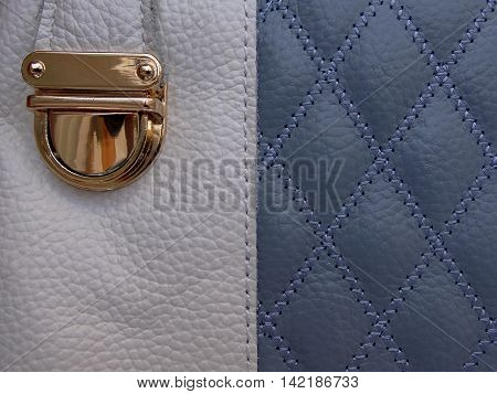 texture blue and white leather with a stitched on her drawings in the form of a rhombus and a gold buckle