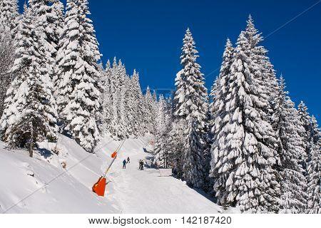 Kopaonik, Serbia - January 19, 2016: Panorama of ski resort Kopaonik, slope, people, mountain view at winter time