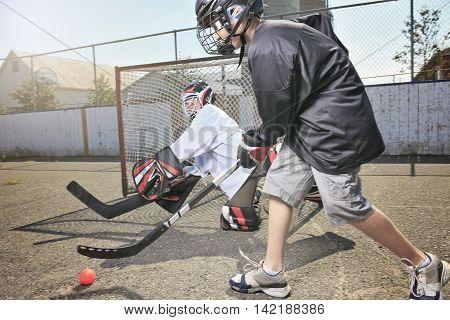 A Portrait of hockey ball players who play hockey.