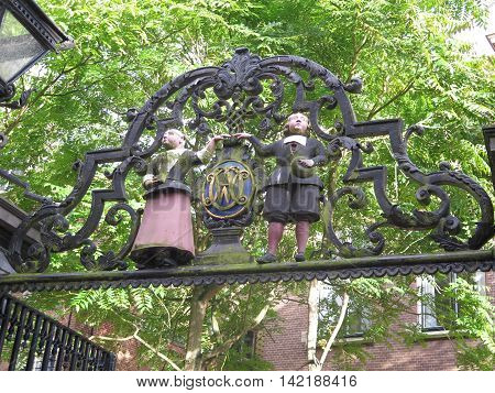Seventeenth century boy and girl figures outside Weeshuis orphanage Enkhuizen Netherlands