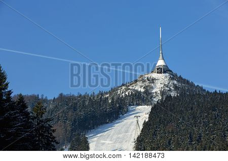 Ski under the funicular to the tower. Beautiful sunny day with blue sky. Jested lookout tower Liberec Bohemia Czech Republic.