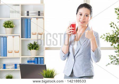 Entrepreneur With Laptop Celebrating Success In Front Of Desk