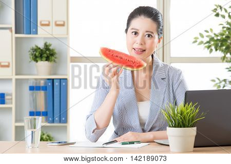 Confidence Asian Business Woman Having Sweet Watermelon To Reduce Temperature Heat