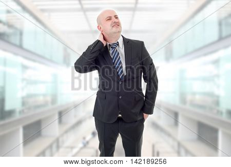 Young businessman with strong back pain, at the office