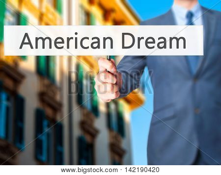 American Dream - Businessman Hand Holding Sign