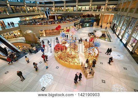 HONG KONG - CIRCA JANUARY, 2016: the atrium of The Landmark. The Landmark is an office and shopping development owned by Hongkong Land in Central, Hong Kong.