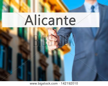 Alicante - Businessman Hand Holding Sign