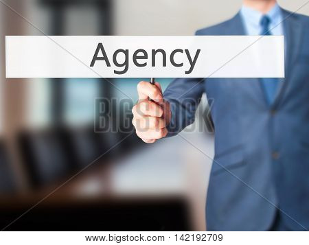 Agency - Businessman Hand Holding Sign