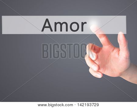 Amor - Hand Pressing A Button On Blurred Background Concept On Visual Screen.