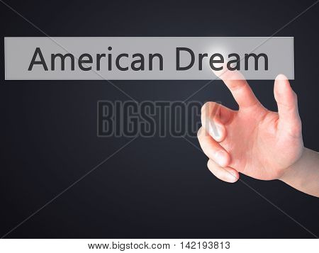 American Dream - Hand Pressing A Button On Blurred Background Concept On Visual Screen.