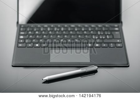 Tablet Keyboard With Pen On Shiny Surface